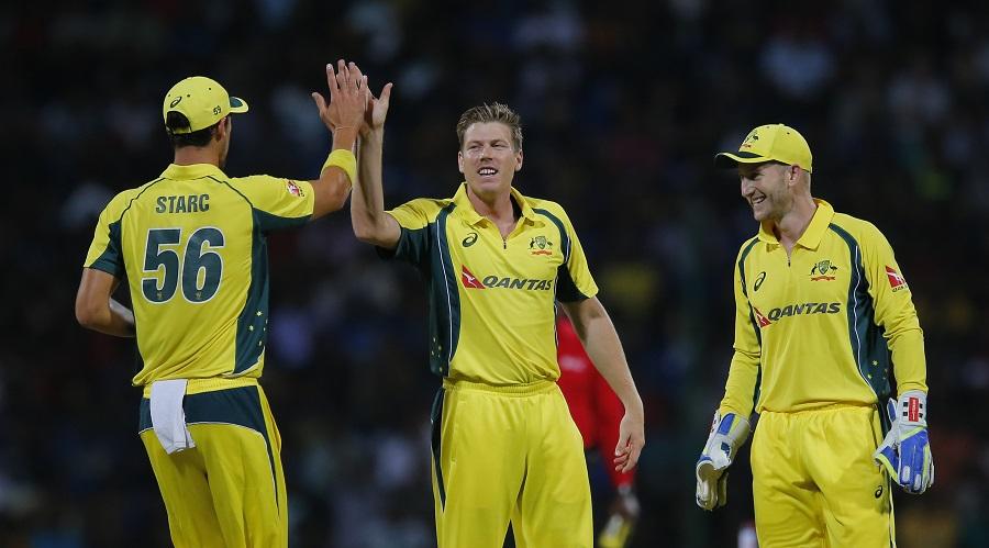 Australia's James Faulkner, center, celebrates the wicket of Sri Lanka's Dhananjaya de Silva with teammates during their first twenty20 cricket match in Pallekele, Sri Lanka, Tuesday, Sept. 6, 2016. (AP Photo/Eranga Jayawardena)
